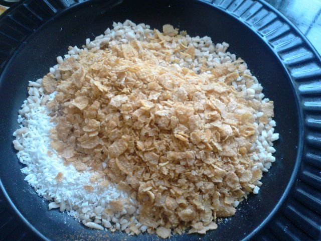 Add your coconut, cinnamon, cornflakes and nuts to a bowl ready for rolling.
